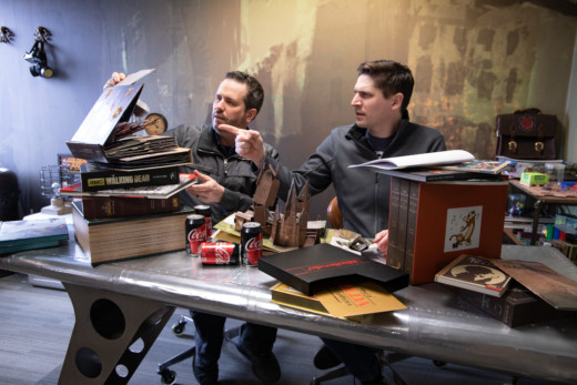 Josh and Ghillie with lots of fancy books
